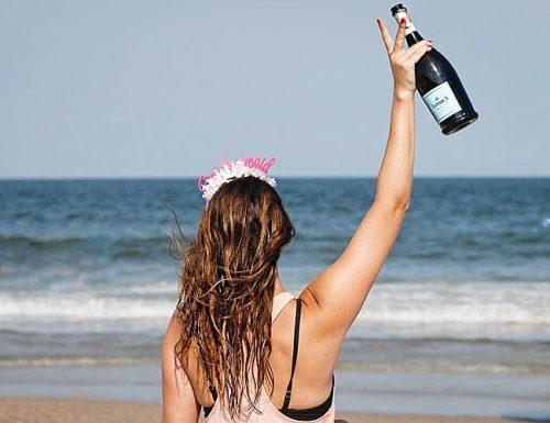 bachelorette party drinking games future bride at the beach with champagne