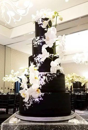 black wedding cake white flower casacade on the cake luxsucredesserts