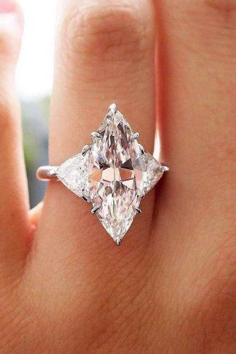 engagement ring marquise cut diamond three stones gold