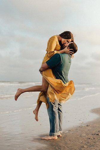 beach photoshoot movie inspired photo shoot man kissing a woman