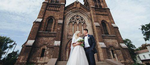 catholic wedding vows bride and groom near church