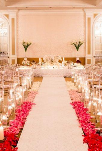 coral wedding decorations coral aisle with candles Lisa Boggs Photography