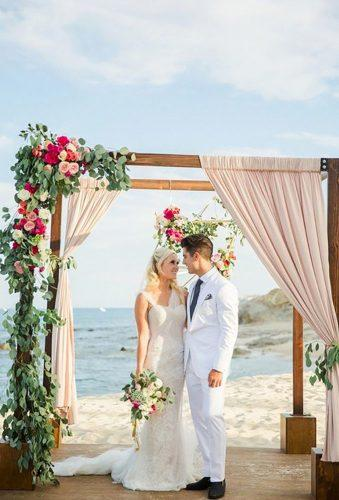 destination weddings decorations arch with flower and tulle Sara Richardson