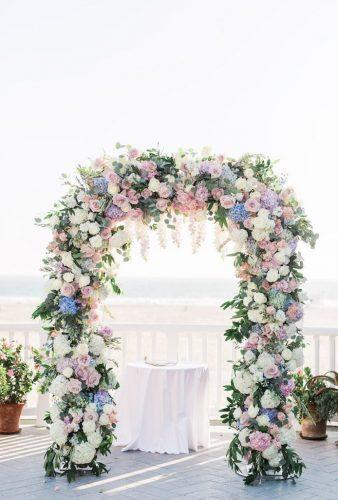destination weddings decorations color flower arch Valorie Darling Photography