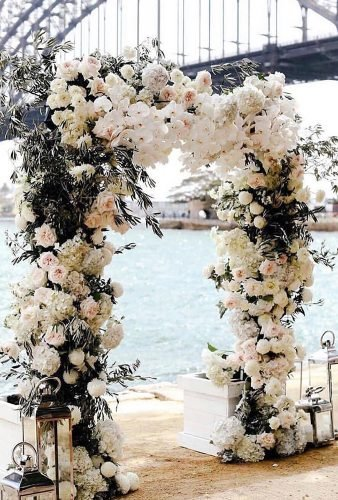 destination weddings decorations white floral arch larahotzphotography