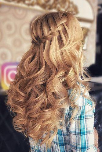 wedding hairstyles 2019 braided waterfall on long curly blonde hair naida_style