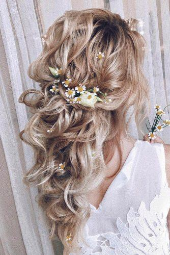 wedding hairstyles 2019 curly half up half down on blonde hair with flowers in bohemian style my_wedmakeup