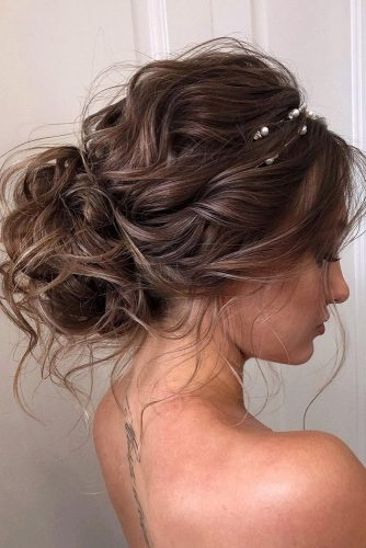 wedding hairstyles 2019 curly low bun with loose curls veronika_belyanko