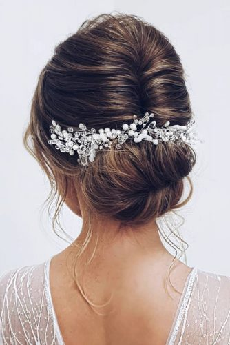 wedding hairstyles 2019 low bun with loose curls and silver accessorie ksenya_makeup