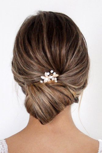 wedding hairstyles 2019 low french roll on dark hair with pin nicoledrege