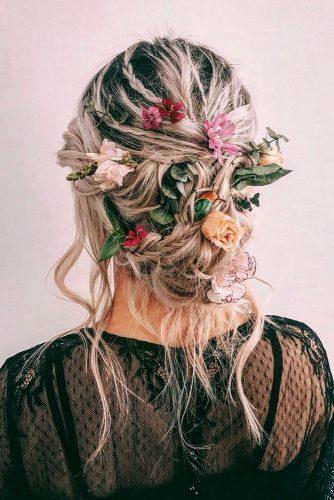 wedding hairstyles 2019 messy updo on blonde hair with bright flowers cruzmakeup