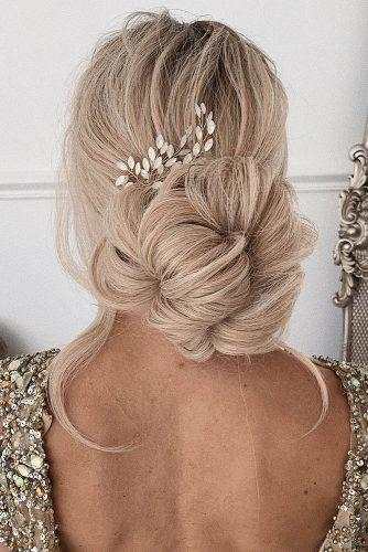 wedding hairstyles 2019 on blonde long hair volume low bun with crystal pin from ulyana.aster