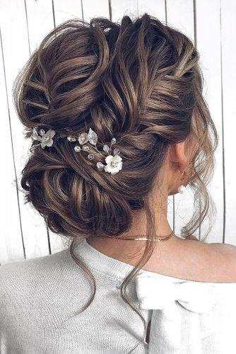 wedding hairstyles 2019 textured low bun with loose curls mpobedinskaya