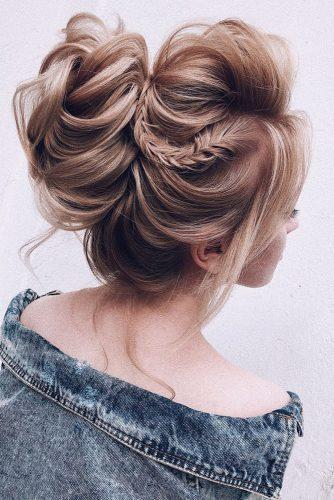 wedding hairstyles 2019 updo hidh bun with thin braid on blonde hair my_wedmakeup