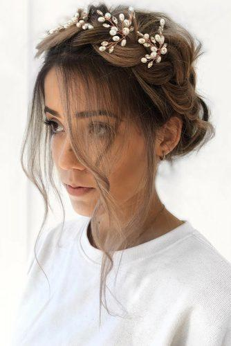 wedding hairstyles 2019 updo with braided crown loose curls and accessorie ulyanaasterbridal