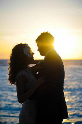 wedding photo shoot essentials couple near sea Sunset