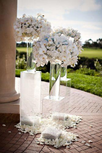 wedding trends 2019 clean actylic stand in tall glass vaces and chic white orchid flowers jasmine star