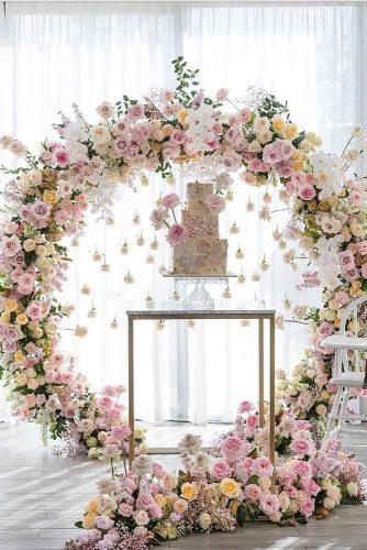 wedding trends 2019 elegant cake table with hanging pare pink white orchid flower arch georgejohnphotography