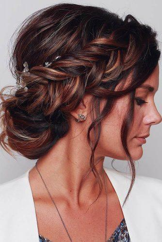 wedding trends 2019 elegant royal bun with side braid and loose curls blushandmane