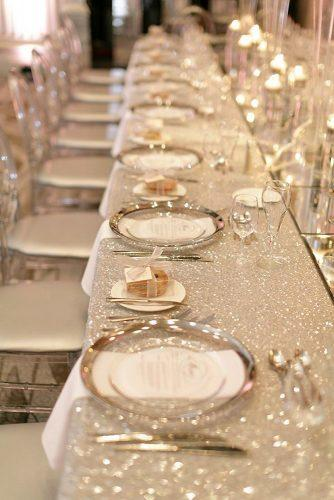 wedding trends 2019 long table with silver tablecloth and plates mango studios