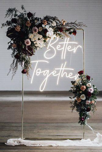 wedding trends 2019 minimalistic arch dark moody flowers and neon romantic sign littlepineappleneon