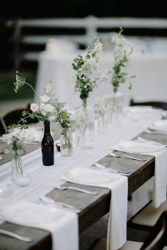 wedding trends 2019 minimalistic black white tablerunner centerpieces with flowers in glass brad and jen photography