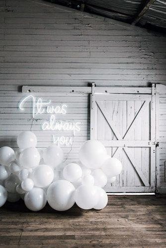 wedding trends 2019 white barn décor with balloons and romantic neon signs littlepineappleneon