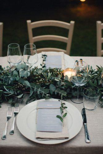 wedding trends 2019 white burlap tablecloth and greenery eucalyptus table runner with candles duepunti wedding photography