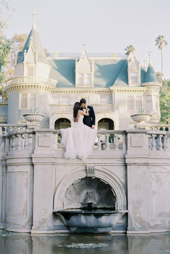 besame wedding styled shoot bride in a dress with train and bridegroom in front of an italian castle above the fountain carrie king photographer
