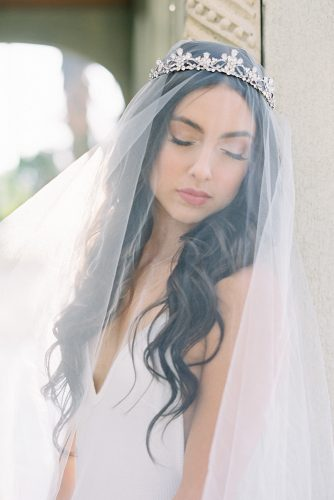 besame wedding styled shoot bride with dark loose curls under the veil and silver crown carrie king photographer
