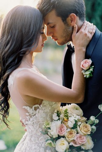 besame wedding styled shoot romantic photography bride with dark loose curls and bouquet groom with boutonniere carrie king photographer
