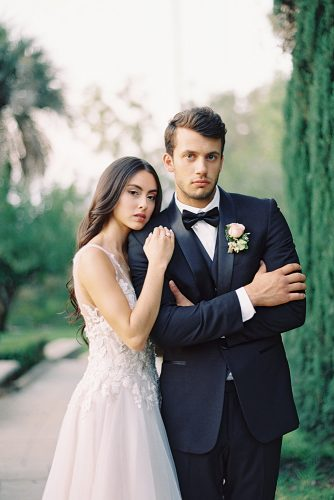 besame wedding styled shoot romantic photography bride with dark loose curls and groom with boutonniere carrie king photographer