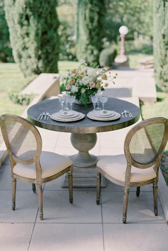 besame wedding styled shoot round small outdoor table with beige plates carrie and flower roses centerpiece besame events carrie king photographer