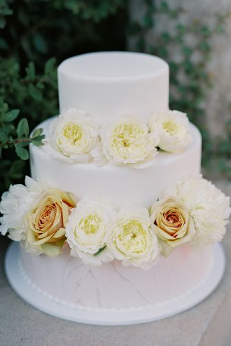 besame wedding styled shoot simple three tired white marble cake with peach roses carrie king photographer
