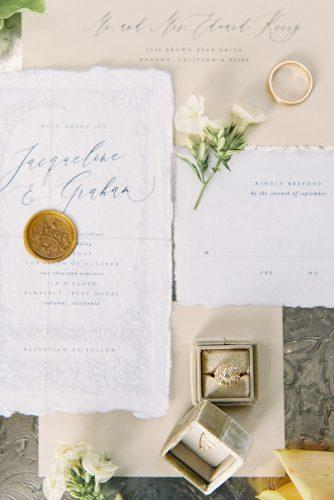besame wedding styled shoot wedding calligraphic invitations and rings in a beige box carrie king photographer
