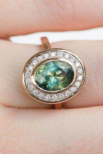 engagement ring oval cut vintage gold halo green gemstone