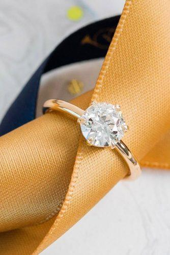 engagement ring simple gold solitaire round cut diamond