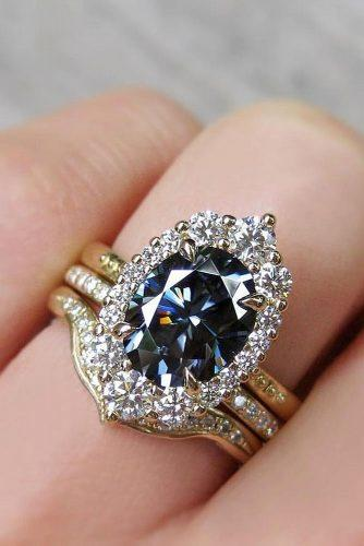 engagement ring trends 2019 oval cut colored grey diamond halo set