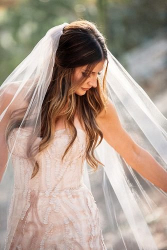half up half down wedding hairstyles half up half down hairstyle with beachy waves under the veil janeinthewoods