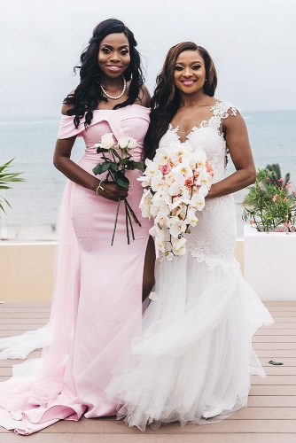 real wedding cindy glen bride in lace dress with cascading bouquet with her bridesmaid in pink dress with white roses stanlo photography