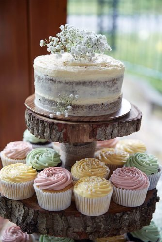 small rustic wedding cakes naked with baby breath and pastel creamy cupcakes natalie j weddings photography