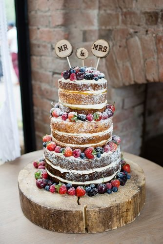small rustic wedding cakes tree tired with berries and wooden signs top jo hastings photography