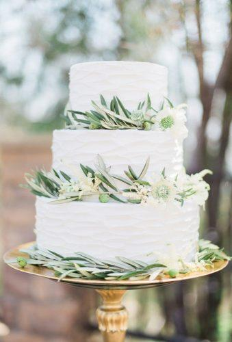 bohemian wedding cakes cake with greenery Stephanie Ponce Photography
