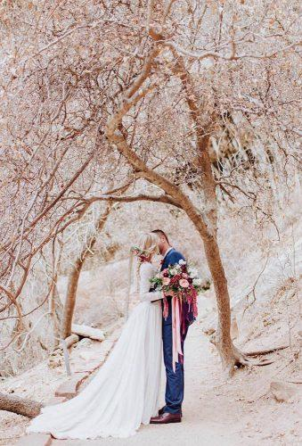 bohemian wedding photos kiss in wood millieolsenphotography