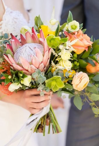 coral wedding decorations bouquet with protea tre fiori floral studio