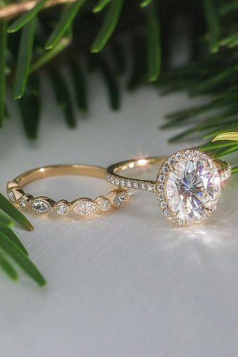 engagement ring inspiration gold diamond halo oval cut set