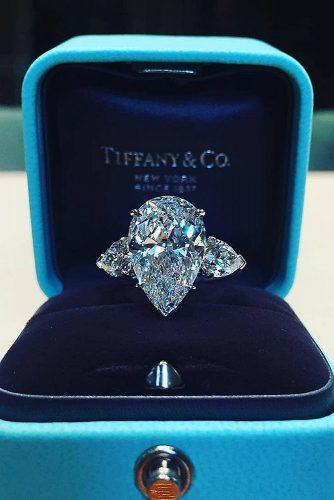 engagement ring inspiration three stones pear cut diamond modern