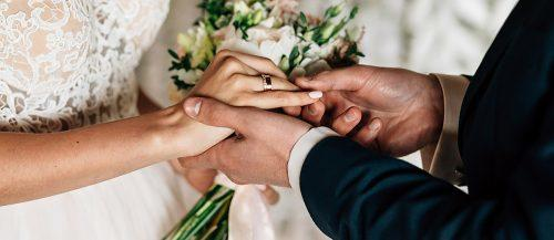 how to officiate a wedding rings exchange bride and groom featured