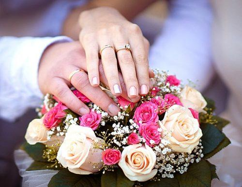 ring exchange wording newlyweds hands boquet rings