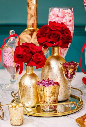 valentines day wedding ideas flower in gold bottle Brian Leahy Photography
